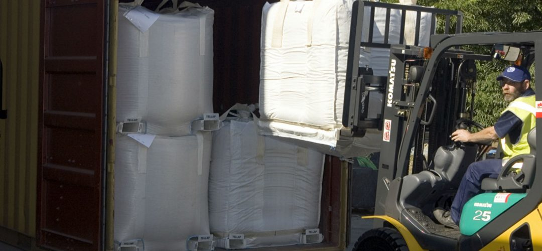 Unloading Tellap bags from container